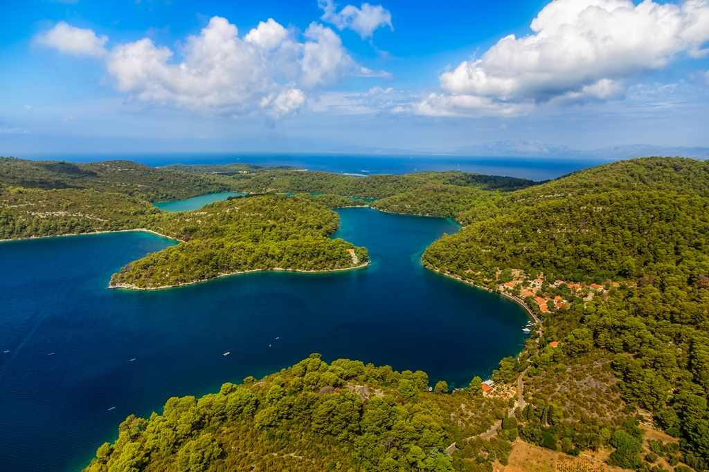 Aerial helicopter shoot of National park on island Mljet, Dubrovnik archipelago, Croatia. The oldest pine forest in Europe preserved.