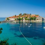 Sveti Stefan small island view from pedestrian walking route in the green park, nearby. Budva, Montenegro.