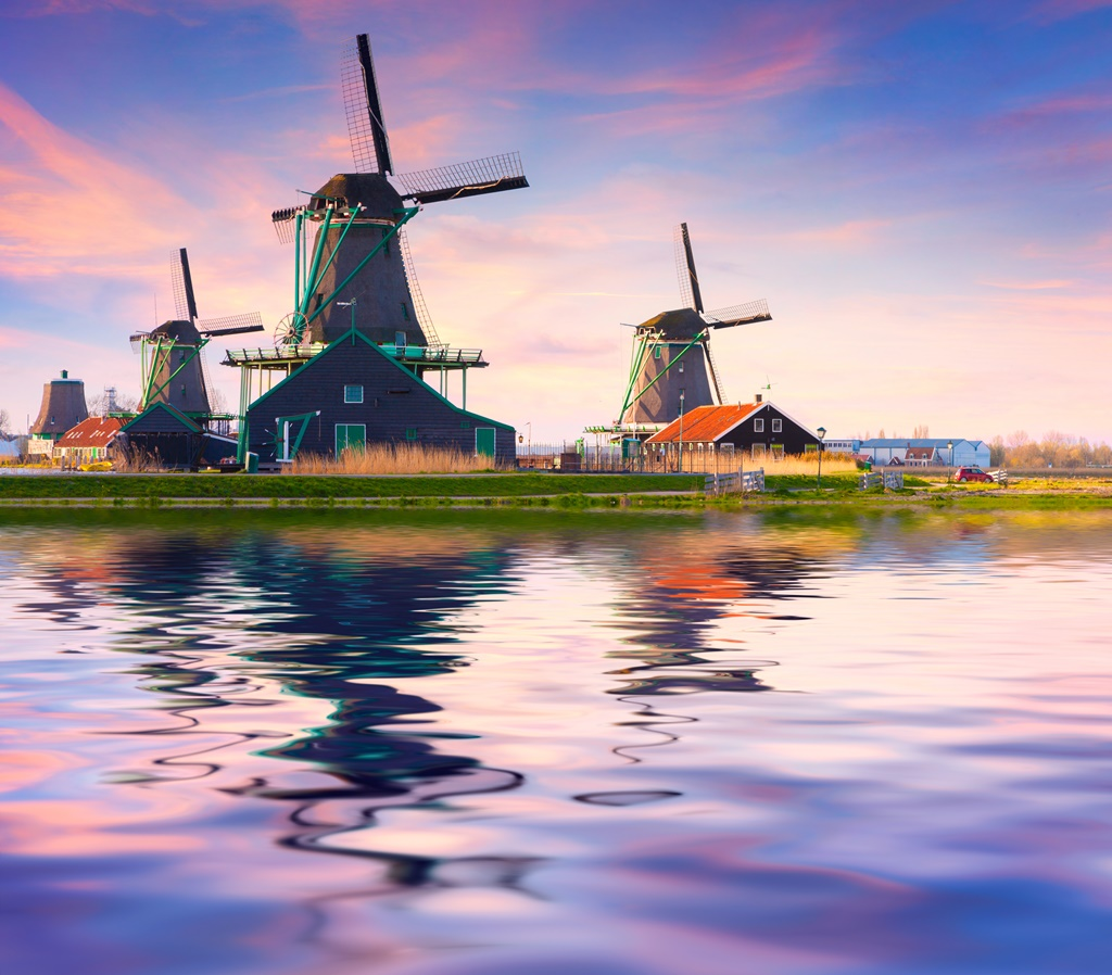 Authentic Zaandam mills on the water channel in Zaanstad willage. Zaanse Schans Windmills and famous Netherlands canals, Europe.