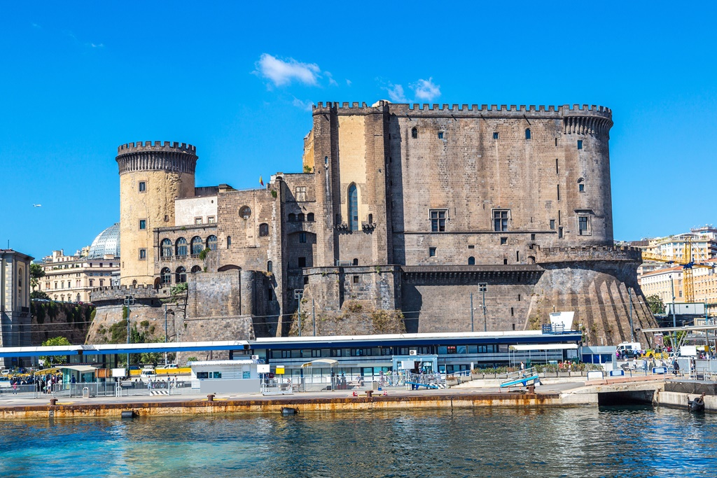 Medieval castle Maschio Angioino in a summer day in Naples, Italy.