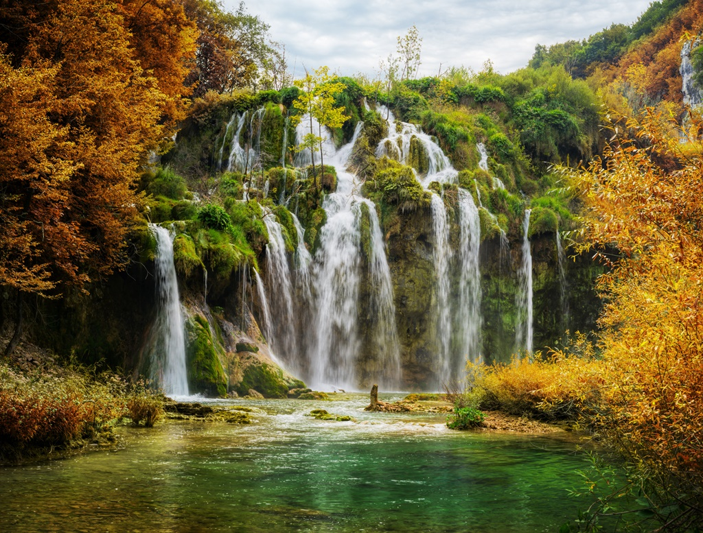 Autumnal view of beautiful waterfalls in Plitvice Lakes National Park, Croatia