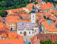 Church of St. Mark and parliament building Zagreb, Croatia. Helicopter aerial view.