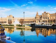 Day sunny view of Plaza de Espana with reflection. Seville, Spain