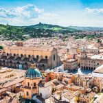 "Bologna,Italy-May 17,2014:panorama of Bologna view from the famous ""Asinelli"" tower located in the centre of the city.You can see the dome of St. Petronio and the central main square."