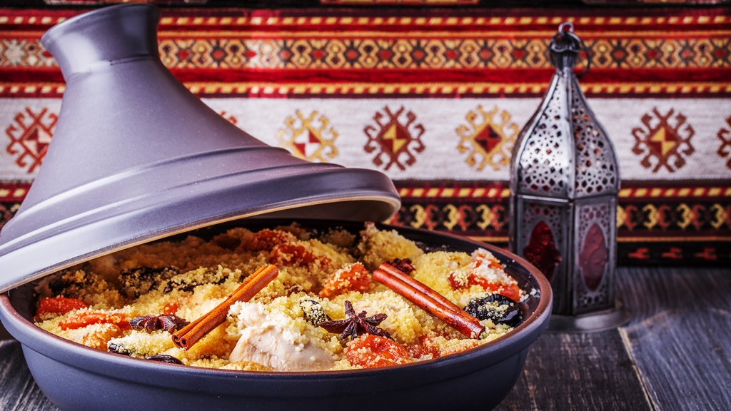 Traditional moroccan tajine of chicken with dried fruits and spices
