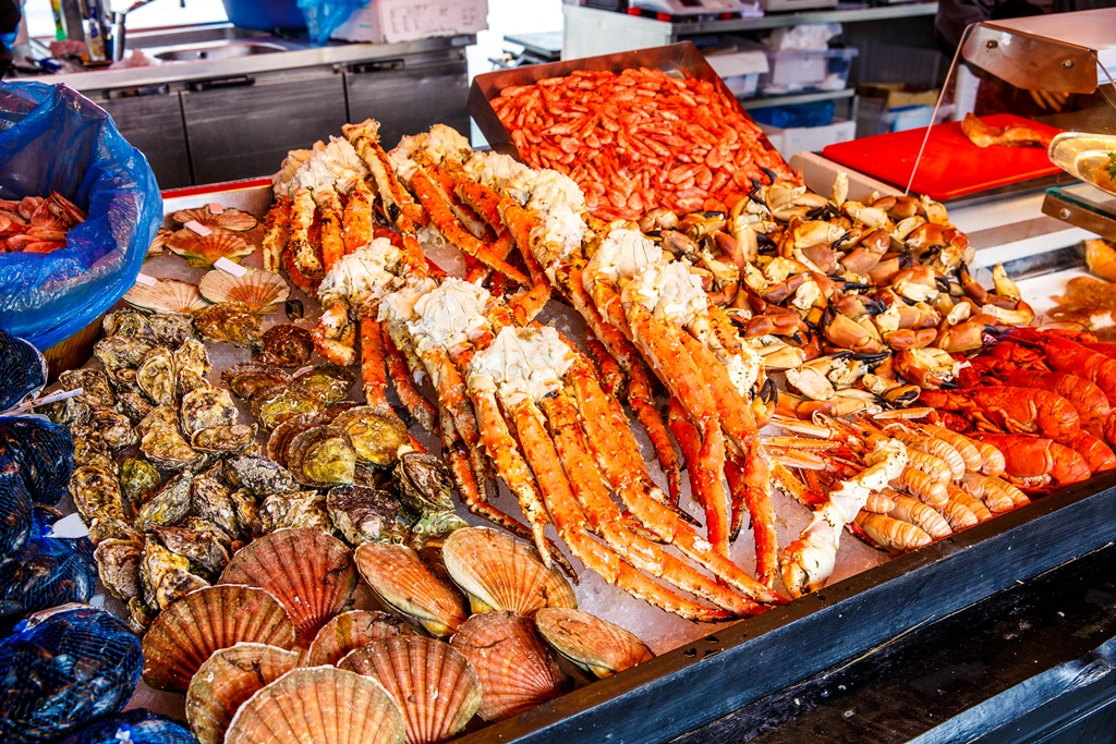 Various seafood on the shelves of the fish market in Norway