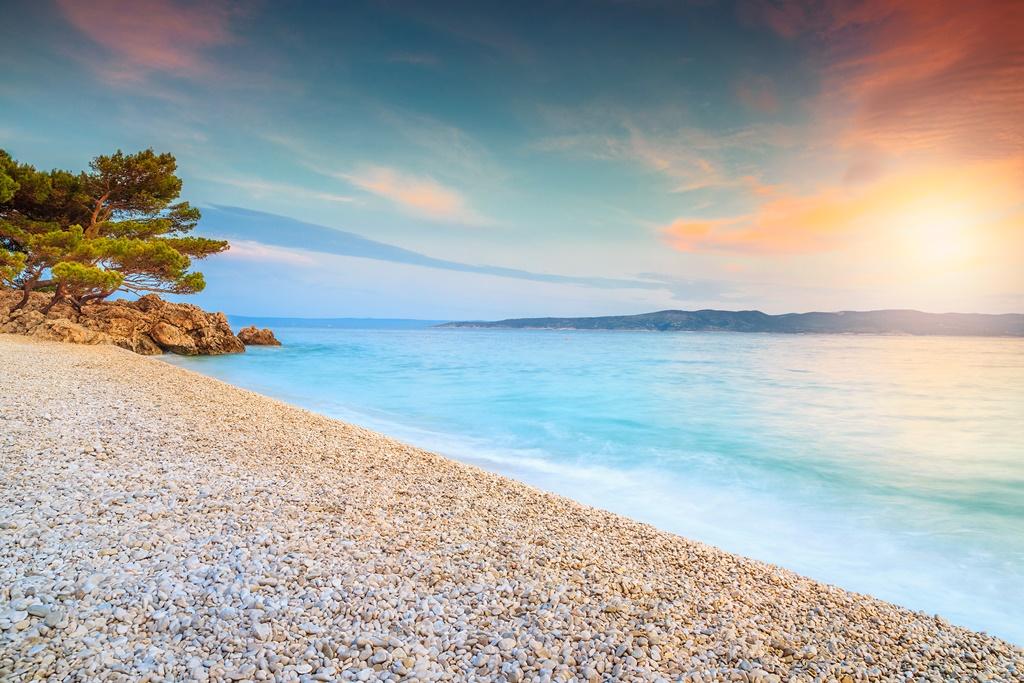 Amazing colorful sunset over the beach, near Brela, Makarska riviera, Dalmatia, Croatia, Europe